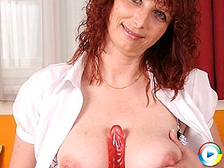Red hot mature nympho playing with only two toys