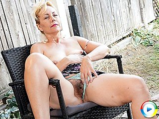 Hairy pussied eighties lady posing totally brunette shows cunt tanned am
