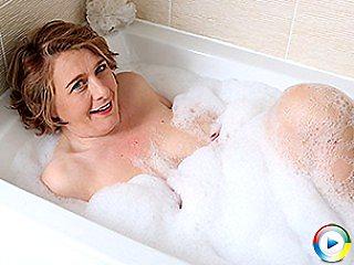 Busty Pale British amateur goth milf bimbo mom gets a bath posing and ma
