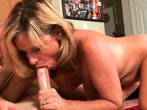 Blonde MILF sucking hell of a dick by the pool